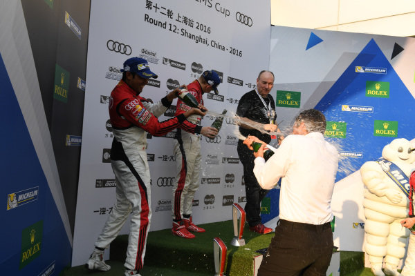 Rene Koneberg (GER) Managing Director Audi Hong Kong & Chairman of the Steering Committee for the Audi R8 LMS Cup celebrates on the Podium in Race 2 and sprays champagne at Aditya Patel (IND) Team Audi R8 LMS Cup 2nd Position, race winner Martin Rump (EST) Champion Racing Team, Akash Nandy (MAL) KCMGd Thong Wei Fung (HK) Phoenix Racing Asia 3rd Position at Audi R8 LMS Cup, Rd11 and Rd12, Shanghai International Circuit, Shanghai, China, 4-5 November 2016.