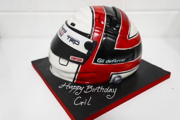 A Marlboro Team Penske crash helmet birthday cake for Gil de Ferran, Sporting Director, McLaren.