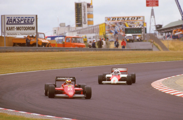 Nurburgring, Germany.2-4 August 1985.Michele Alboreto (Ferrari 156/85) 1st position, leads Alain Prost (McLaren MP4/2B TAG Porsche).Ref-85 GER 08.World Copyright - LAT Photographic