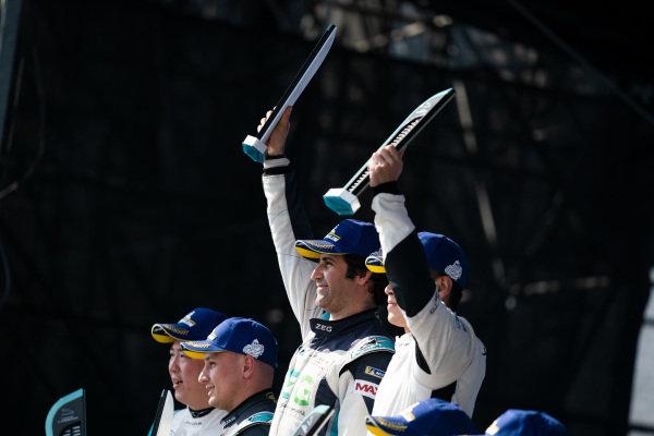 PRO class winner Sérgio Jimenez (BRA), ZEG iCarros Jaguar Brazil with PRO AM class winner Zhang Yaqi (CHI), Jaguar China Racing on the podium