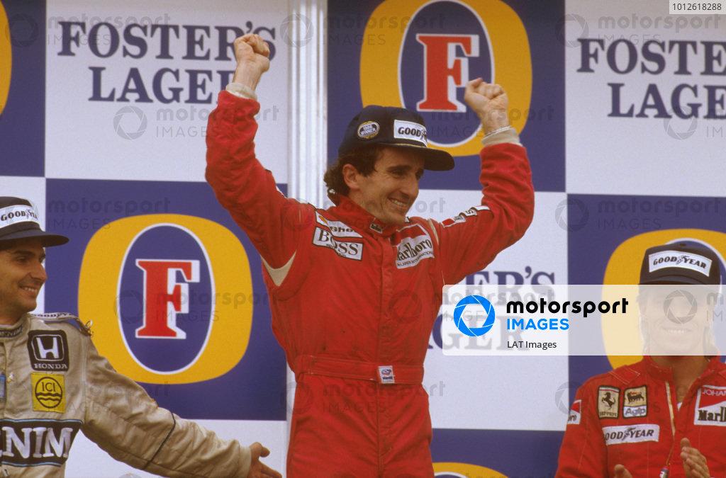 Adelaide, Australia.24-26 October 1986.Alain Prost (McLaren TAG Porsche) 1st position, celebrates becoming World Champion again with Nelson Piquet (Williams Honda) 2nd position and Stefan Johansson (Ferrari) 3rd position on the podium.Ref-86 AUS 10.World Copyright - LAT Photographic