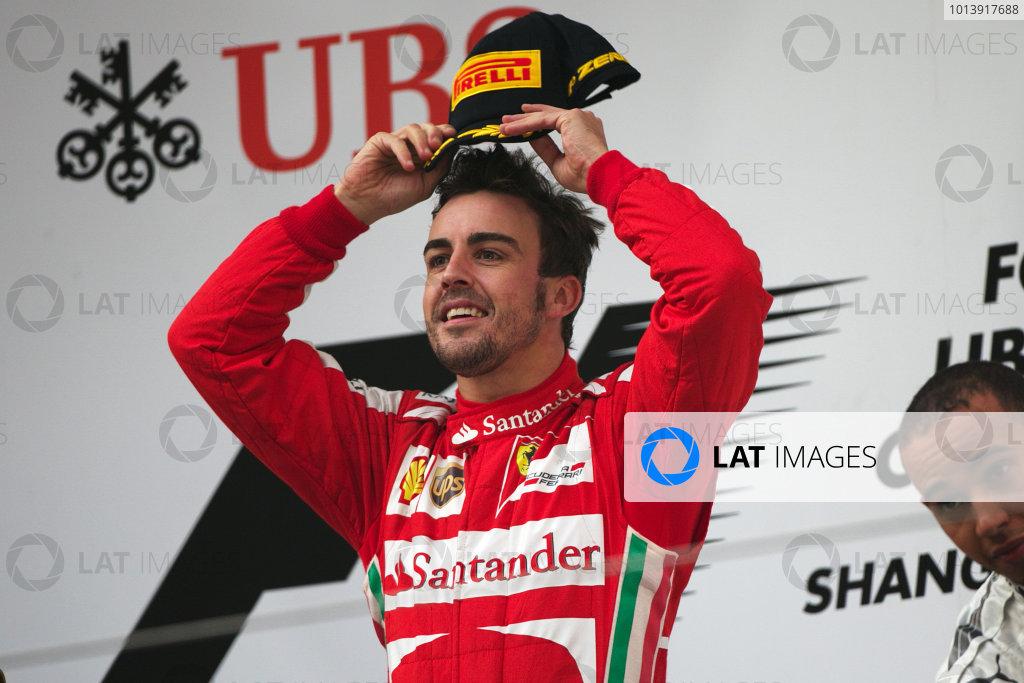 Shanghai International Circuit, Shanghai, China Sunday 14th April 2013 Fernando Alonso, Ferrari, 1st position, celebrates on the podium. World Copyright: Andy Hone/LAT Photographic ref: Digital Image HONZ7861