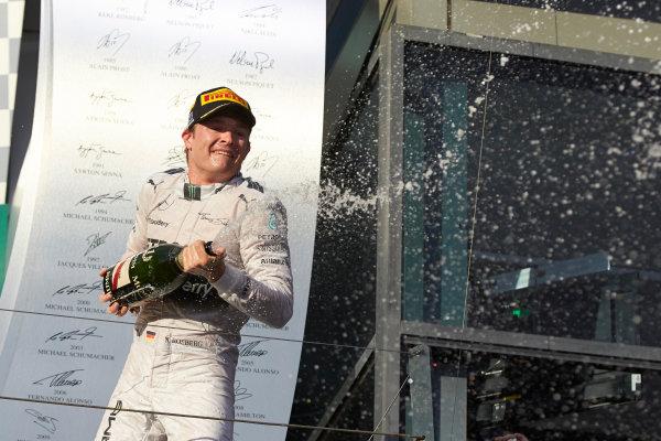 Albert Park, Melbourne, Australia. Sunday 16 March 2014. Nico Rosberg, Mercedes AMG, 1st Position, sprays Champagne from the podium. World Copyright: Steve Etherington/LAT Photographic. ref: Digital Image SNE26238 copy