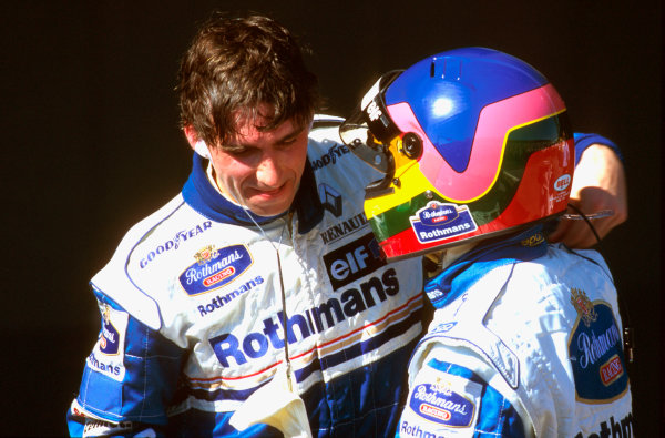 Albert Park, Melbourne, Australia.8-10 March 1996.Damon Hill (Williams Renault)1st position is congratulated by teamate Jacques Villeneuve (Williams Renault) 2nd position in parc ferme. World Copyright - LAT Photographic