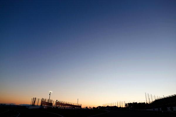 Suzuka Circuit, Suzuka, Japan.  Sunday 27 September 2015. The sun falls behind the circuit after the race. World Copyright: Alastair Staley/LAT Photographic ref: Digital Image _R6T2765