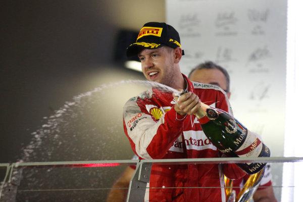 Marina Bay Circuit, Singapore. Sunday 20 September 2015. Sebastian Vettel, Ferrari, 1st Position, sprays Champagne from the podium. World Copyright: Glenn Dunbar/LAT Photographic ref: Digital Image _89P6103