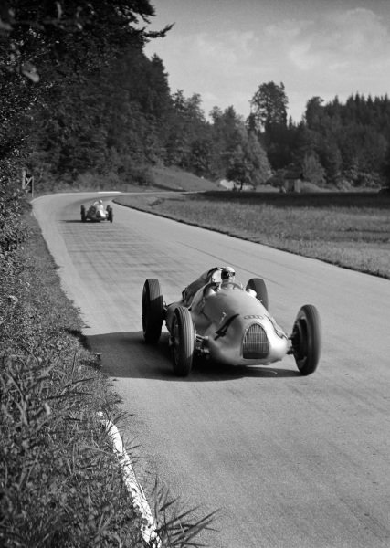 1938 Swiss Grand Prix Bremgarten, Berne, Switzerland. 21st August 1938. Hermann Muller, Auto Union D, retired, leads Hans Stuck, Auto Union D, 4th position, action. World Copyright: Robert Fellowes/LAT Photographic. Ref: 38SUI04.