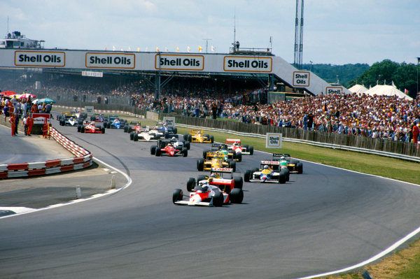 Silverstone, England.10-12 July 1987.Start of the race, action.World Copyright: LAT PhotographicRef: 87 GB 09