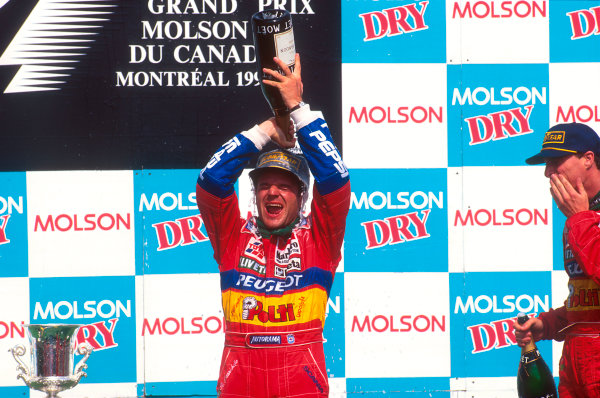 Montreal, Quebec, Canada.9-11 June 1995.Rubens Barrichello (Jordan Peugeot) 2nd position pours champagne over himself with teammate Eddie Irvine, 3rd position also on the podium.Ref-95 CAN 07.World Copyright - LAT Photographic