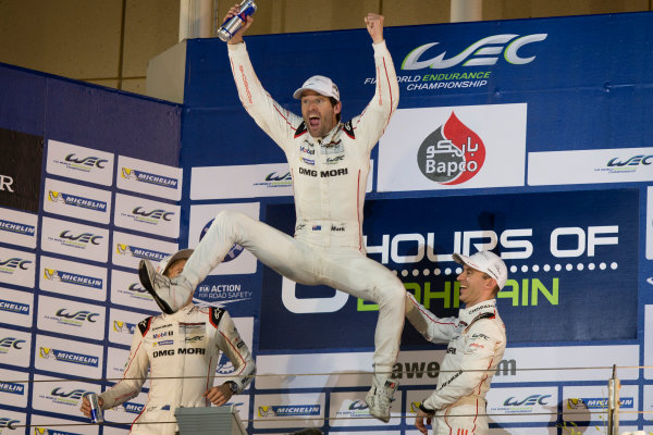 2015 WEC Bahrain International Circuit, Bahrain Saturday 21 November 2015. Mark Webber, Timo Bernhard and Brendon Hartley (#17 Porsche 919 Hybrid) celebrate on the podium after winning the drivers' championship. Photo: Sam Bloxham/LAT ref: Digital Image _SBL5903