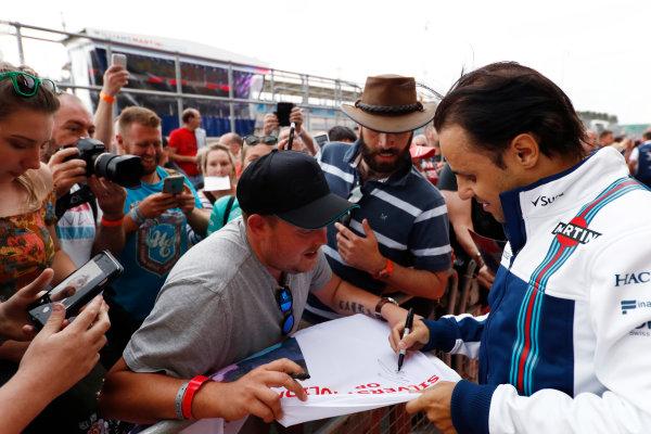 Silverstone, Northamptonshire, UK.  Thursday 13 July 2017. Felipe Massa, Williams Martini Racing, signs autographs for fans. World Copyright: Glenn Dunbar/LAT Images  ref: Digital Image _X4I2379