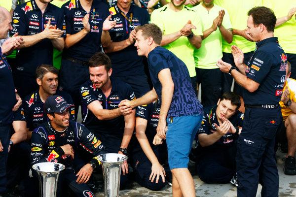 Hungaroring, Budapest, Hungary. Sunday 27 July 2014. Sebastian Vettel, Red Bull Racing, congratulates his team at the post race celebration. World Copyright: Andy Hone/LAT Photographic. ref: Digital Image _ONY2899
