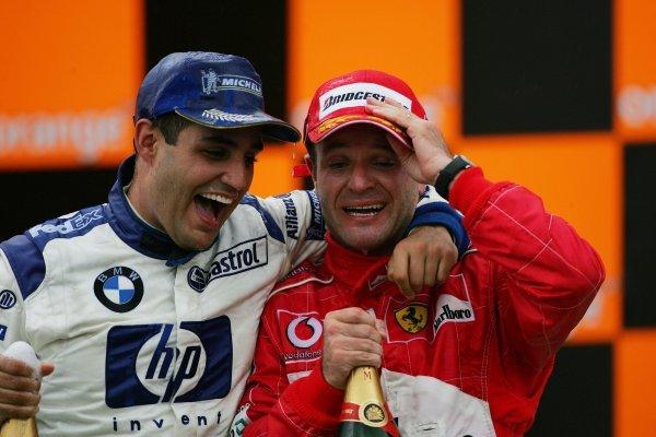 (L to R): Juan Pablo Montoya (COL) Williams and Rubens Barrichello (BRA) Ferrari on the podium.Formula One World Championship, Rd18, Brazilian Grand Prix, Race Day, Interlagos, Brazil, 24 October 2004.DIGITAL IMAGEBEST IMAGE