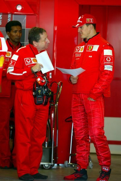 (L to R): Jean Todt (FRA) Ferrari General Manager with Michael Schumacher (GER) Ferrari.Formula One World Championship, Rd15, United States Grand Prix, Indianapolis, USA, 27 September 2003.DIGITAL IMAGE