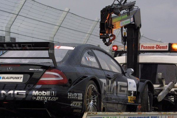 DTM Championship 2002, Round 10 - Hockenheimring, Germany, 6 October 2002 - The wracked car of Jean Alesi (AMG-Mercedes) is taken away after a big shunt in the opening lap of the main race.