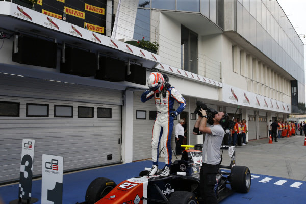 Race one winner Luca Ghiotto (ITA) Trident celebrates in parc ferme at GP3 Series, Rd4, Hungaroring, Hungary, 24-26 July 2015.