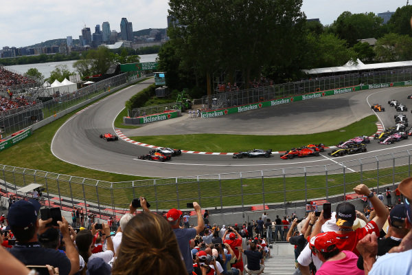 Sebastian Vettel (GER) Ferrari SF-71H leads at the start of the race .