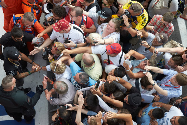 Autodromo Nazionale di Monza, Monza, Italy. Thursday 3 September 2015. Lewis Hamilton, Mercedes AMG, signs autographs for fans. World Copyright: Steve Etherington/LAT Photographic ref: Digital Image SNE23462