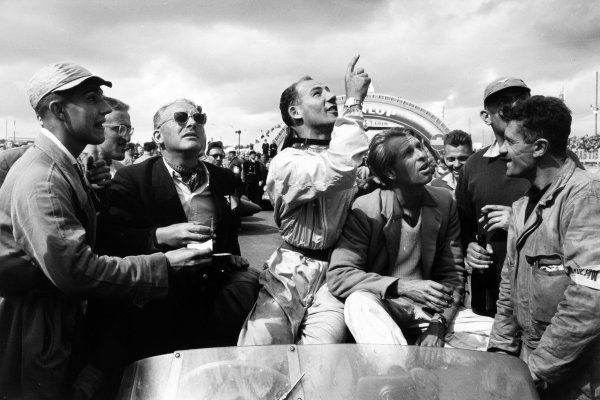 Le Mans, France. 28th - 29th July 1956. Stirling Moss/Peter Collins (Aston Martin DB3S), 2nd position, look up into the sky before the start of the race, portrait.  World Copyright: LAT Photographic. Ref: Autosport b&w print
