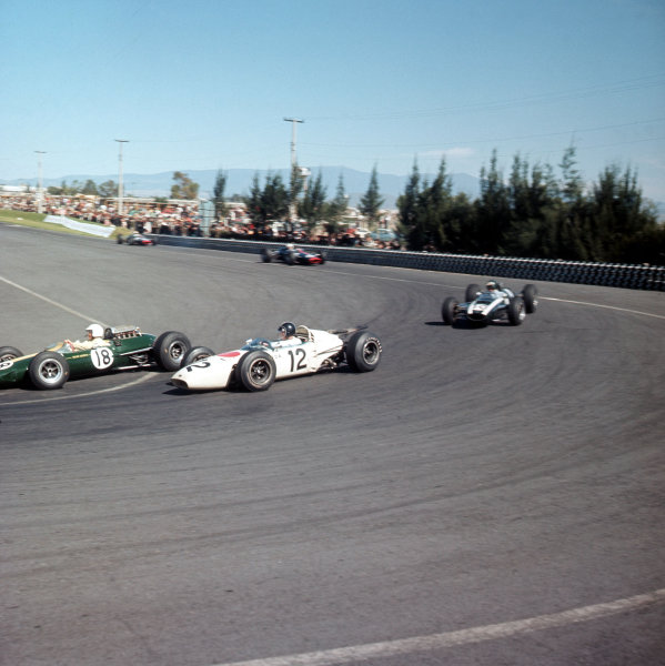Mexico City, Mexico.22-24 October 1965.Moises Solana (Lotus 25 Climax) leads Ronnie Bucknum (Honda RA272) and Jochen Rindt (Cooper T73 Climax).Ref-3/1865.World Copyright - LAT Photographic