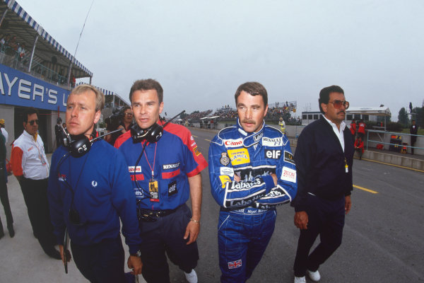 Montreal, Quebec, Canada.31/5-2/6 1991. Nigel Mansell (Williams FW14 Renault) walks with Peter Windsor and Chief Mechanic, portrait. Ref: 91CAN18. World Copyright - LAT Photographic