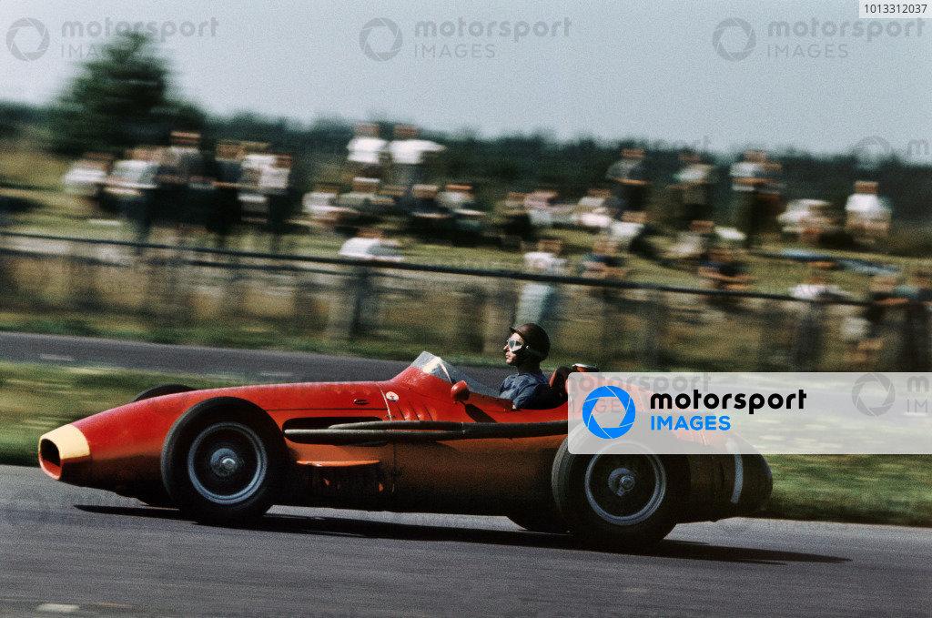 Nurburgring, Germany. 2-4 August 1957.Juan Manuel Fangio (Maserati 250F) 1st position, action.Ref-57 GER 18.World Copyright - Tony Smythe/LAT Photographic