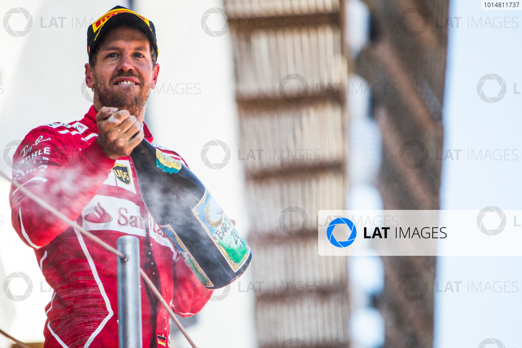 Circuit de Catalunya, Barcelona, Spain. Sunday 14 May 2017. Sebastian Vettel, Ferrari, 2nd Position, sprays the Champagne. World Copyright: Dom Romney/LAT Images ref: Digital Image GT2R1896