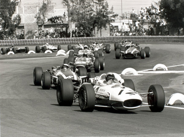1966 Mexican Grand Prix. Mexico City, Mexico. 23 October 1966.Richie Ginther, Honda RA273, 4th position, leads Jochen Rindt, Cooper T81-Maserati, retired, Jack Brabham, Brabham BT20-Repco, 2nd position, Denny Hulme, Brabham BT20-Repco, 3rd position, John Surtees, Cooper T81-Maserati, 1st position, at the start, action.World Copyright: LAT PhotographicRef: 1419/20A