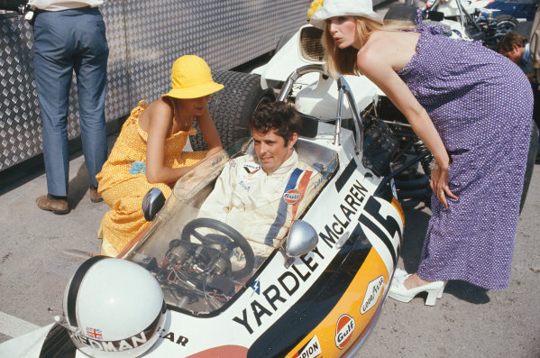 1972 Monaco Grand Prix.  Monte Carlo, Monaco. 11-14th May 1972.  Brian Redman, McLaren M19A Ford, in the pits with fashion models.  Ref: 72MON14. World Copyright: LAT Photographic