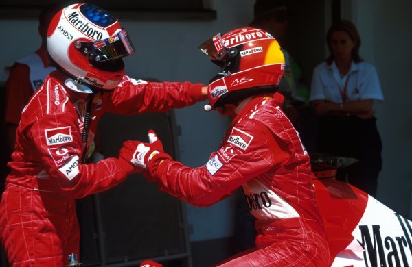 Rubens Barrichello (BRA), Ferrari 2nd place congratulates race winner Michael Schumacher (GER). The two switched places approaching the finish line to enhance Schumacher's championship standing.