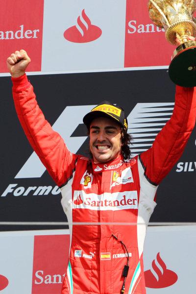 Race winner Fernando Alonso (ESP) Ferrari celebrates on the podium. Formula One World Championship, Rd 9, British Grand Prix, Race, Silverstone, England, Sunday 10 July 2011.  BEST IMAGE