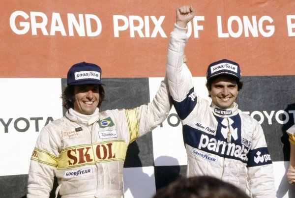 1980 United States Grand Prix West.Long Beach, California, USA. 28-30 March 1980.Nelson Piquet (Brabham BT49-Ford Cosworth), 1st position and Emerson Fittipaldi (Fittipaldi F7-Ford Cosworth), 3rd position on the podium.World Copyright: LAT PhotographicRef: 35mm transparency 80LB15