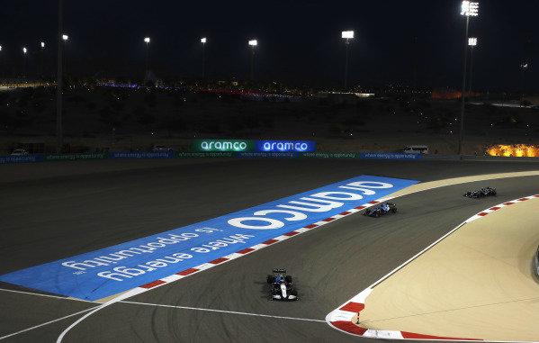 Nicholas Latifi, Williams FW43B, leads Fernando Alonso, Alpine A521