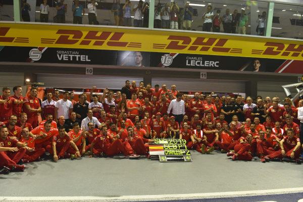 Charles Leclerc, Ferrari, 2nd position, Sebastian Vettel, Ferrari, 1st position, and the Ferrari team celebrate