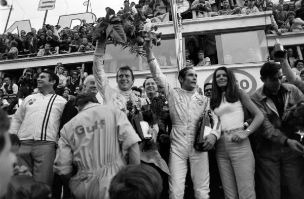 Jacky Ickx and Jackie Oliver celebrate their victory on the podium.