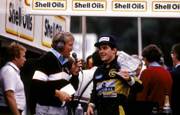 Brian Jones (left), the Brands Hatch commentator, interviews second place finisher Ayrton Senna (BRA) Lotus on the podium. European Grand Prix, Brands Hatch, England, 6 October 1985.