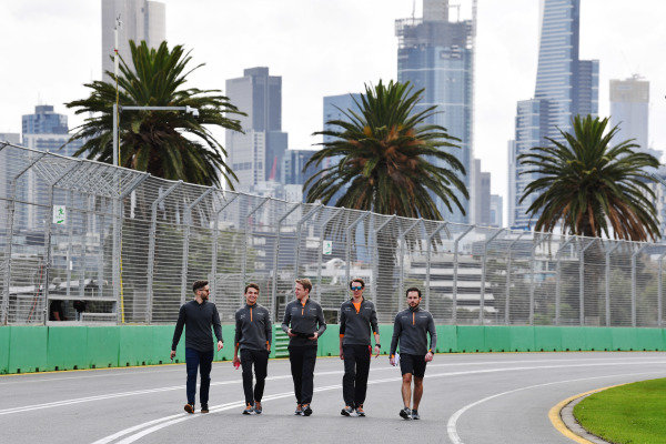 Lando Norris, McLaren, walks the track with his team