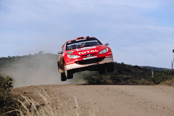 2003 World Rally ChampionshipRally Argentina, Cordoba, Argentina, 7th - 11th May 2003.Rally winner Marcus Gronholm/Timo Rautiainen (Peugeot 206 WRC), action.World Copyright: LAT Photographicref: 03WRCArg04