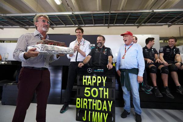 Interlagos, Sao Paulo, Brazil. Saturday 14 November 2015. Eddie Jordan presents a birthday cake to Mercedes engineer Jimmy for his 50th. World Copyright: Steve Etherington/LAT Photographic ref: Digital Image SNE22090