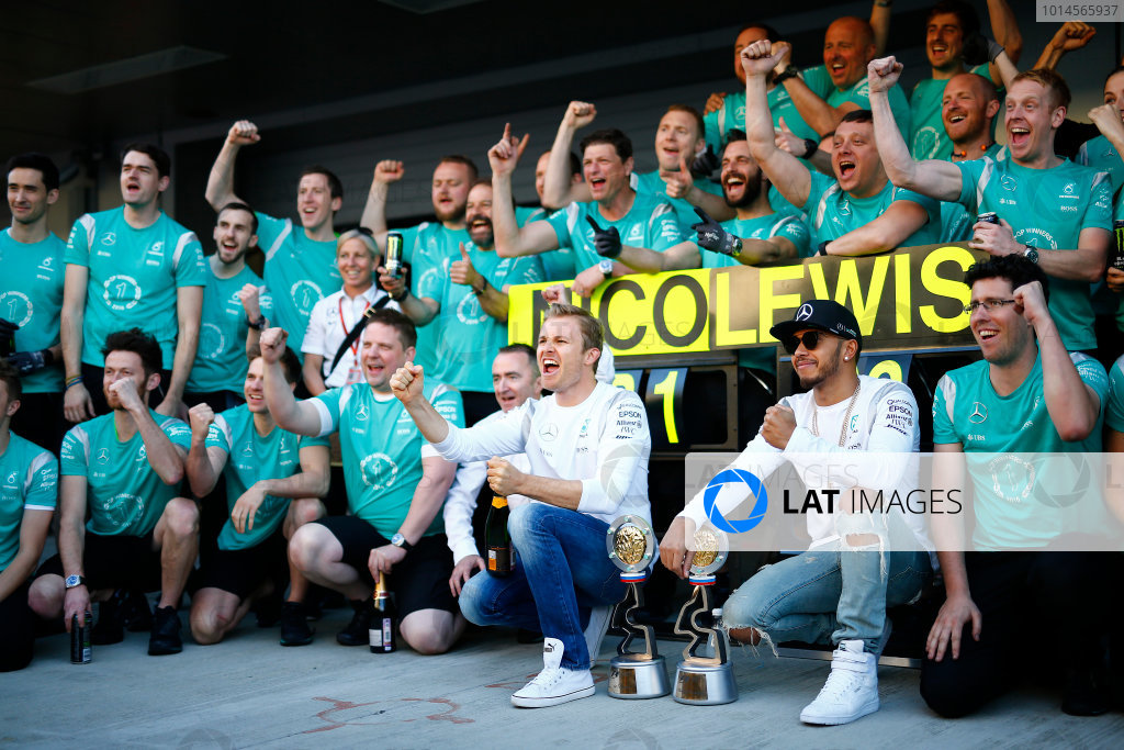 Sochi Autodrom, Sochi, Russia. Sunday 1 May 2016. Nico Rosberg, Mercedes AMG, 1st Position, Lewis Hamilton, Mercedes AMG, 2nd Position, and the Mercedes team celebrate victory. World Copyright: Andy Hone/LAT Photographic ref: Digital Image _ONZ9136