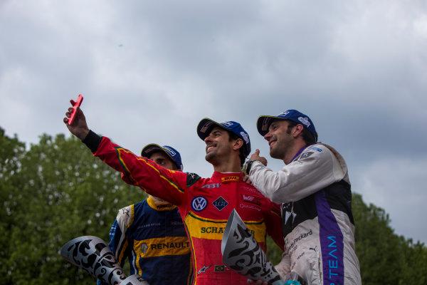 2015/2016 FIA Formula E Championship. Paris ePrix, Paris, France. Saturday 23 April 2016. Sebastien Buemi (SUI), Renault e.Dams Z.E.15, Lucas Di Grassi (BRA), ABT Audi Sport FE01 and Jean-Eric Vergne (FRA), DS Virgin Racing DSV-01 take a selfie on the podium. Photo: Zak Mauger/LAT/Formula E ref: Digital Image _79P9457