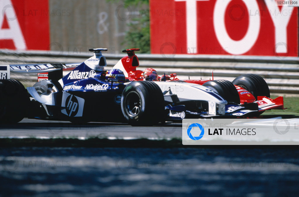 2003 Italian Grand Prix,Monza, Italy.12th - 14th September 2003Michael Schumacher, Ferrari F2003 GA and Juan-Pablo Montoya, BMW Williams FW25 battle for first position, race action.World Copyright LAT Photographic/Lorenzo Bellanca.ref:35mm image