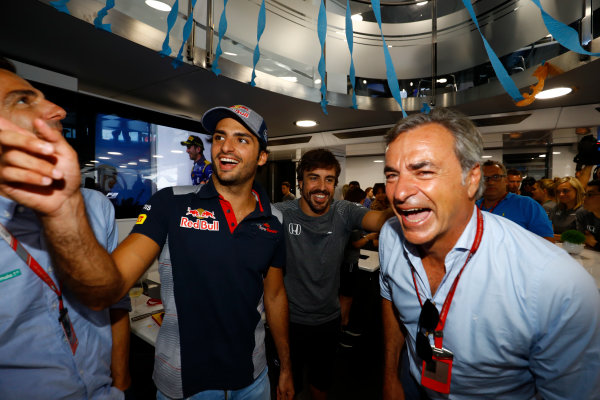 Hungaroring, Budapest, Hungary.  Saturday 29 July 2017. Pedro de la Rosa, Carlos Sainz Jr, Toro Rosso, Fernando Alonso, McLaren, who celebrates his 36th birthday, and Carlos Sainz Sr.  World Copyright: Steven Tee/LAT Images  ref: Digital Image _R3I3649