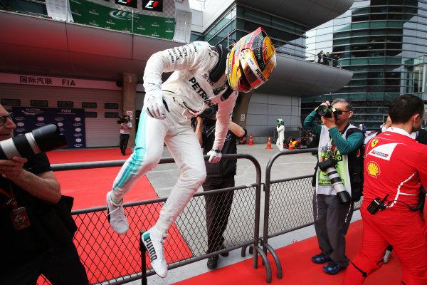 Shanghai International Circuit, Shanghai, China.  Saturday 08 April 2017.  Lewis Hamilton, Mercedes AMG, celebrates pole in Parc Ferme. World Copyright: Charles Coates/LAT Images  ref: Digital Image AN7T8990