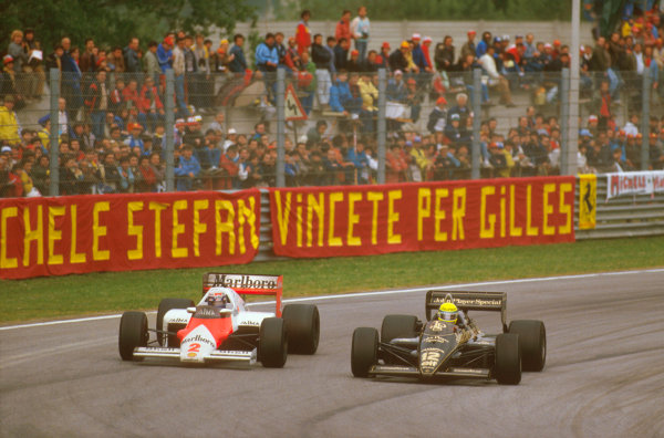 Imola, Italy. 3-5 May 1985. Alain Prost (McLaren MP4/2B TAG Porsche) battles with Ayrton Senna (Lotus 97T Renault) on the way to 1st position. Prost was later disqualified due to the car being under weight at the finish.  Ref-85 SM 04. World Copyright - LAT Photographic