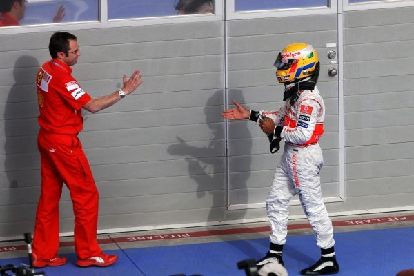 (L to R): Stefano Domenicali (ITA) Ferrari Manager of F1 Operations with Lewis Hamilton (GBR) McLaren.