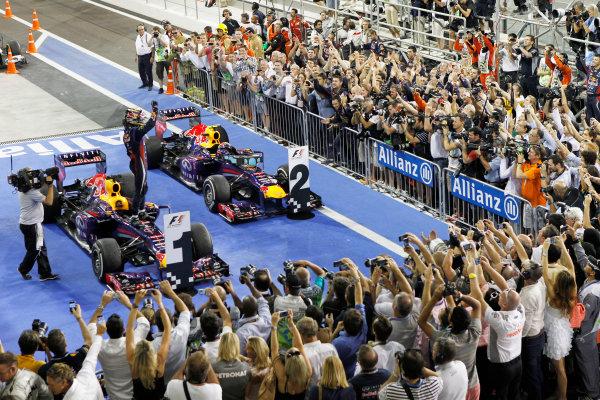 Yas Marina Circuit, Abu Dhabi, United Arab Emirates. Sunday 3rd November 2013. Sebastian Vettel, Red Bull RB9 Renault, 1st position, and Mark Webber, Red Bull RB9 Renault, 2nd position, arrive in Parc Ferme. World Copyright: Jed Leicester/LAT Photographic. ref: Digital Image _JED0680