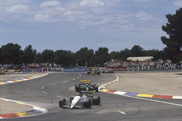 Paul Ricard, Le Castellet, France. 1st - 3rd July 1988. Oscar Larrauri (EuroBrun ER188-Ford), retired, leads Pierluigi Martini (Minardi M188-Ford), 15th position, action.  World Copyright: LAT Photographic. Ref: 88FRA 63