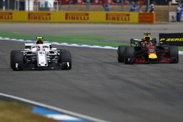 Daniel Ricciardo, Red Bull Racing RB14 Tag Heuer, passes Charles Leclerc, Sauber C37 Ferrari.