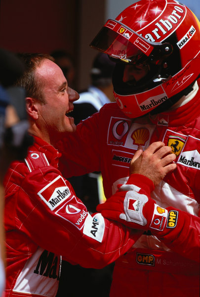2002 San Marino Grand Prix.Imola, Italy.12-14 April 2002.Michael Schumacher and Rubens Barrichello (both Ferrari) celebrate 1st and 2nd positions respectively in parc ferme.Ref-02 SM 31.World Copyright - LAT Photographic